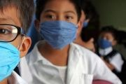 Children wear surgical masks at 'Enrique Rebsamen' school in Oaxaca, Mexico, Sept. 25, 2009. Three cases of Influenza A (H1N1) virus (swine flu) were confirmed in the school at the time.