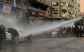 Turkish riot police use a water cannon to disperse Kurdish demonstrators during a protest against a curfew in Sur district and security operations in the region, in the southeastern city of Diyarbakir, Turkey Jan. 17, 2016.