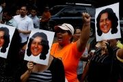 Protesters demonstrate with photos of murdered Indigenous leader Berta Caceres in Tegucigalpa, Honduras, March 3, 2016.