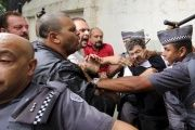 Supporters of former Brazilian president Luiz Inacio Lula da Silva confront police officers during a protest in front of Lula's apartment in Sao Bernardo do Campo, Brazil March 4, 2016.