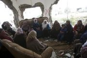 Palestinians gather in the home of Mohammed al-Haroub after it was partially demolished by Israeli army in the West Bank village of Dir Samt, south of Hebron Feb. 23, 2016.