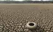 A tire rests on the dry bed of Lake Mendocino, a key Mendocino County reservoir, in Ukiah, California Feb. 25, 2014.