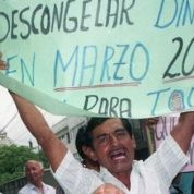 Ecuadoreans protest the neoliberal measures adopted by the government of Jamil Mahuad in order to save the banking industry in 1999.