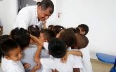 Correa is embraced by students at the opening of the Wankurishpa Yachana Pampa Mushuk Ayllu school in Orellana, Ecuador, March 8, 2016.