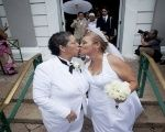 Alma Rosado (L) and Flor Maria kiss after their wedding in San Juan, Puerto Rico, Aug. 16, 2015.