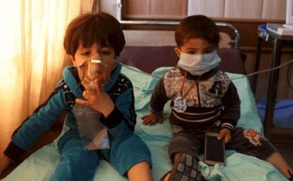 Children receive oxygen, after suffering from choking, at a hospital in Taza south of Kirkuk, March 9, 2016.