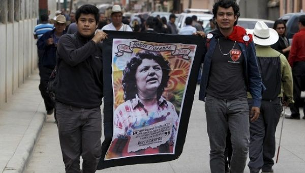 Supporters carry a banner with an image of Berta Caceres along a street during her funeral in the town of La Esperanza, Honduras, March 5, 2016.