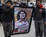 Supporters carry a banner with an image of slain environmental rights activist Berta Caceres.