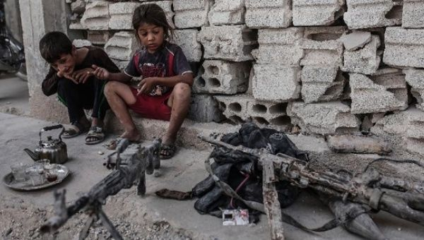 Children look at seized weapons from the Islamic State group on September 6, 2015 in Kobane, northern Syria.