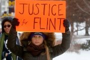 Demonstrators protest over the Flint, Michigan, contaminated water crisis outside of the venue where the Democratic U.S. presidential candidates' debate was being held in Flint, Michigan.