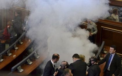 Opposition politicians release tear gas in parliament to obstruct a session in Pristina, Kosovo.