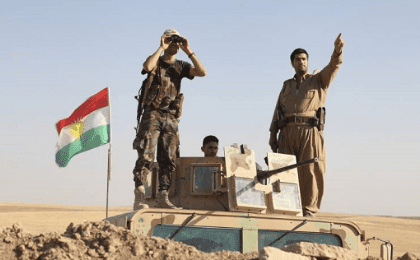 Kurdish peshmerga troops participate in an intensive security deployment against Islamic State group militants in Khazer.