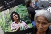 A woman with a poster of slain environmental activist Berta Caceres