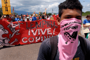 The Honduran organization COPINH, founded by murdered activist Berta Caceres, protests militarization of communities in 2011.