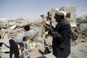 A man shouts for help to salvage his furniture after his house was destroyed by a Saudi-led air strike in Yemen's capital Sanaa, Feb. 25, 2016.