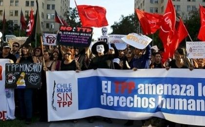 Demonstrators protest against the Trans-Pacific Partnership in front of the government house in Santiago, Chile, Feb. 4, 2016.