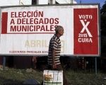 A man walks past near a poster announcing the next Cuban municipal elections in Havana April 6, 2015.