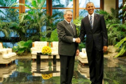 U.S. President Barack Obama and Cuba's President Raul Castro shake hands during their first meeting of Obama's visit to Cuba, in Havana March 21, 2016.