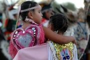 Young Native American dancers stand together during the Oglala Nation Pow Wow and Rodeo in Pine Ridge, South Dakota, Aug. 4, 2006.