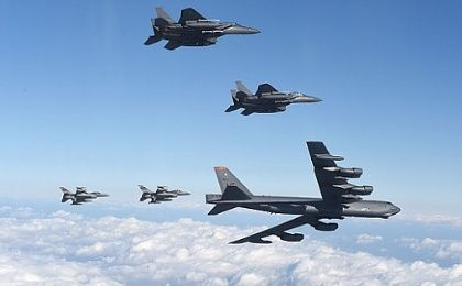 A U.S. B-52 Stratofortress flying with South Korean F-15K fighter jets and US F-16 fighter jets over South Korea.