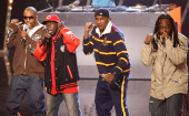 A Tribe Called Quest, Phife Dawg is seen wearing the red baseball cap.