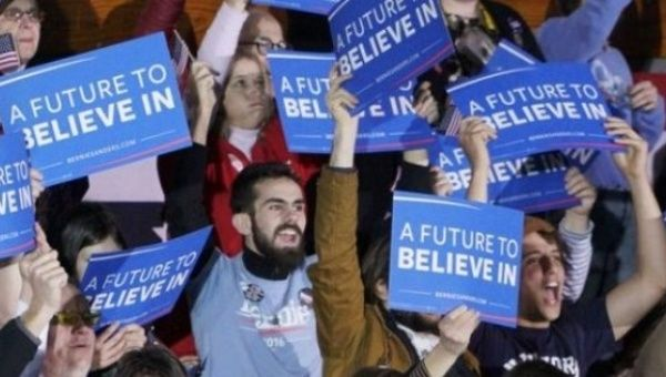 Supporters of Bernie Sanders cheer at a rally in New Hampshire.