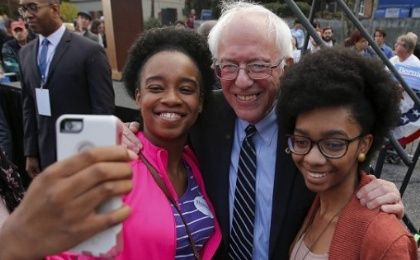 Bernie Sanders and two supporters outside the Columbia Democratic Party headquarters.