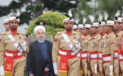 Iranian President Hassan Rouhani reviews the guard of honor at the Prime Minister's house in Islamabad, Pakistan, in this March 25, 2016 handout photo.