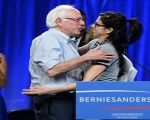 U.S. presidential candidate Bernie Sanders is greeted by comedian Sarah Silverman before speaking during a campaign rally at the Los Angeles in 2015.