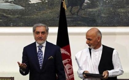 Afghan rival presidential candidates Abdullah Abdullah (L) and Ashraf Ghani stand together after exchanging signed agreements for the country's unity government in Kabul September 21, 2014.
