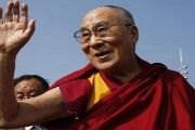 Tibetan spiritual leader the Dalai Lama waves to devotees outside the United Nations where the Human Rights Council is holding its 31st Session in Geneva, Switzerland, March 11, 2016.