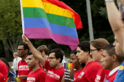 Demonstrators with the group GetEQUAL hold a protest with lesbian, gay, bisexual and transgender (LGBT) individuals affected by the country's immigration policies during a rally outside the White House in Washington, DC, on Sept. 9, 2014.