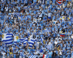 Uruguay's fans cheer before the start of the Group D soccer match between Uruguay and Costa Rica in Fortaleza on June 14, 2014
