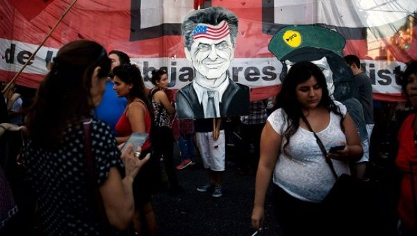 A protest sign depicts President Mauricio Macri during a demonstration against a settlement with holdout creditors in Buenos Aires, March 15, 2016.