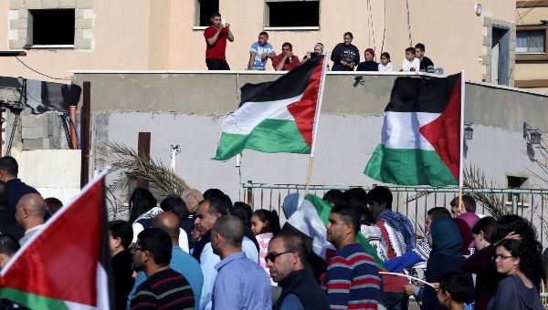 Palestinian demonstrators take part in a Land Day rally in the northern Israeli village of Arrabe, March 30, 2016