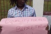 A member of Guyana's Transgender Community Protests outside the court in the county's capital, Georgetown.