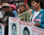 Families of supporters of the 43 disappeared Ayotzinapa students protest in Mexico City, Aug. 26, 2015.