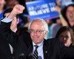 U.S. Democratic presidential candidate Bernie Sanders celebrates victory during a primary night rally.