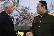 U.S. Navy Adm Timothy Keating (L), commander of the U.S. Pacific Command, greets China's General Guo Boxiong at the Ba Yi Building in Beijing Jan. 14, 2008.
