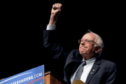 Democratic U.S. presidential candidate Bernie Sanders pumps his fist after announcing he won the Wisconsin primary at a campaign rally at the University of Wyoming in Laramie, Wyoming April 5, 2016.