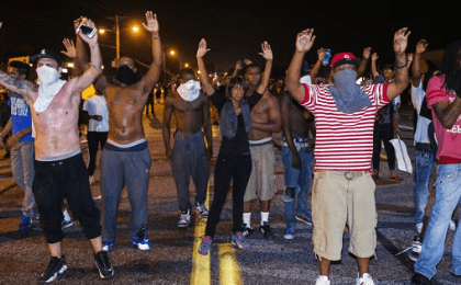 Protesters in Ferguson, Mo., chant