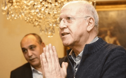 Former Lebanese Information Minister Michel Samaha gestures at his house after being released in Beirut, Lebanon, Jan. 14, 2016.