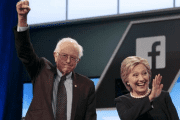 Senator Bernie Sanders and Hillary Clinton wave before the start of the Democratic U.S. presidential candidates debate in Kendall, Florida, March 9, 2016.