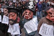 Activists protest state complicity in the case of the 43 Ayotzinapa students, two months after they were forcibly disappeared in September 2014.