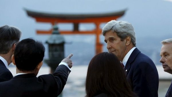 U.S. Secretary of State John Kerry listens to Japanese Foreign Minister Fumio Kishida as they and G7 foreign ministers visit the Itsukushima Shrine in Japan, April 10, 2016.