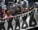 Students protest in front of the attorney general's office in Mexico City during a protest over the disappearance of 43 Ayotzinapa students in Iguala, Guerrero.