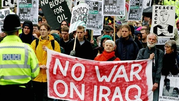 British anti-war protesters demonstrate outside army headquarters in Northwood, Middlesex, January 19, 2003.