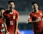 Chinese players celebrate their 2-0 victory over Qatar in a 2018 World Cup football qualifying match in Xi'an, Shanxi province