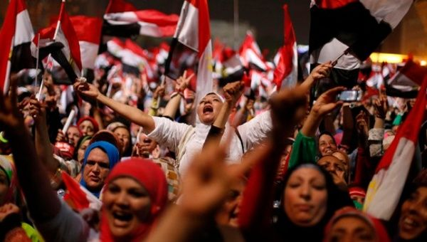 Egyptians Protesters react in Tahrir Square in Cairo July 3, 2013.