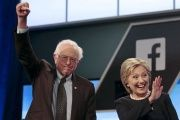 Democratic presidential candidates Senator Bernie Sanders and Hillary Clinton wave before a debate in Kendall, Florida, March 9, 2016.